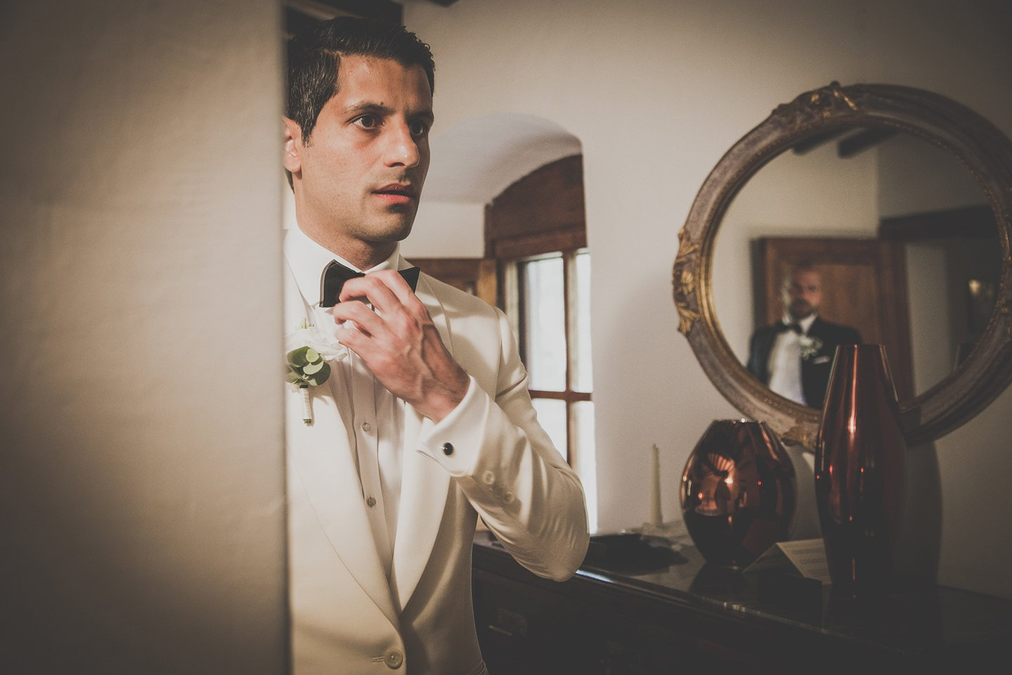 iranian-groom-white-jacket-getting-ready-vignamaggio-tuscany-