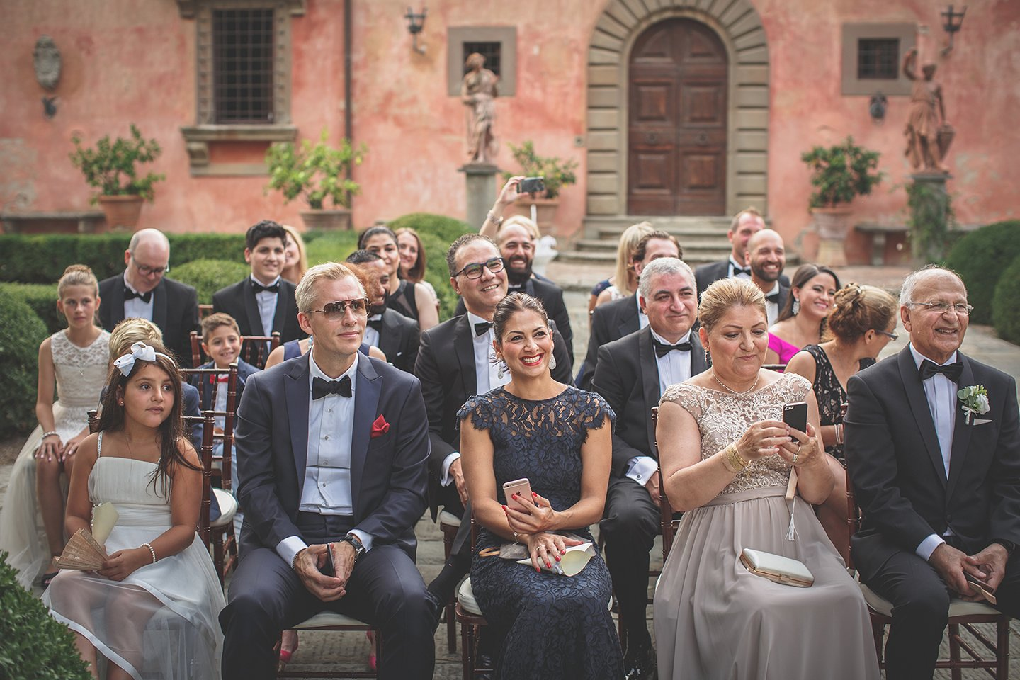 guests-outdoor-blessing-wedding-ceremony-Vignamaggio-Tuscany-