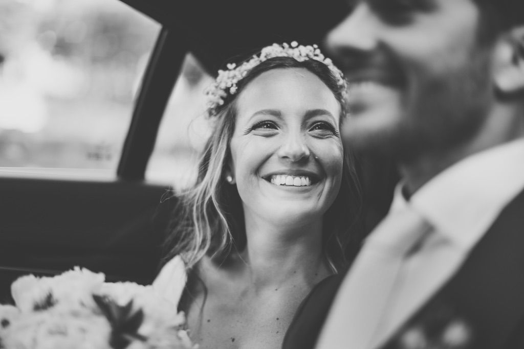 smiling-bride-groom-wedding-car