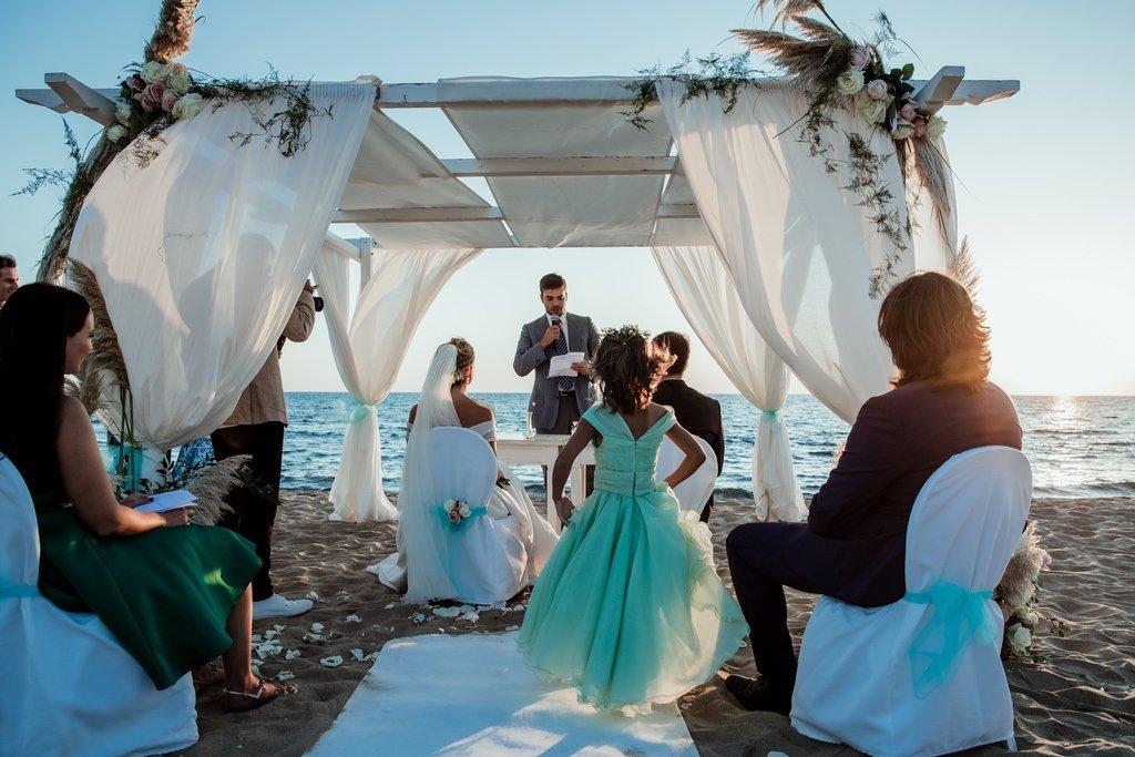 sunset-beach-wedding-ceremony-Sabaudia-Oasi-di-Kufra-Hotel