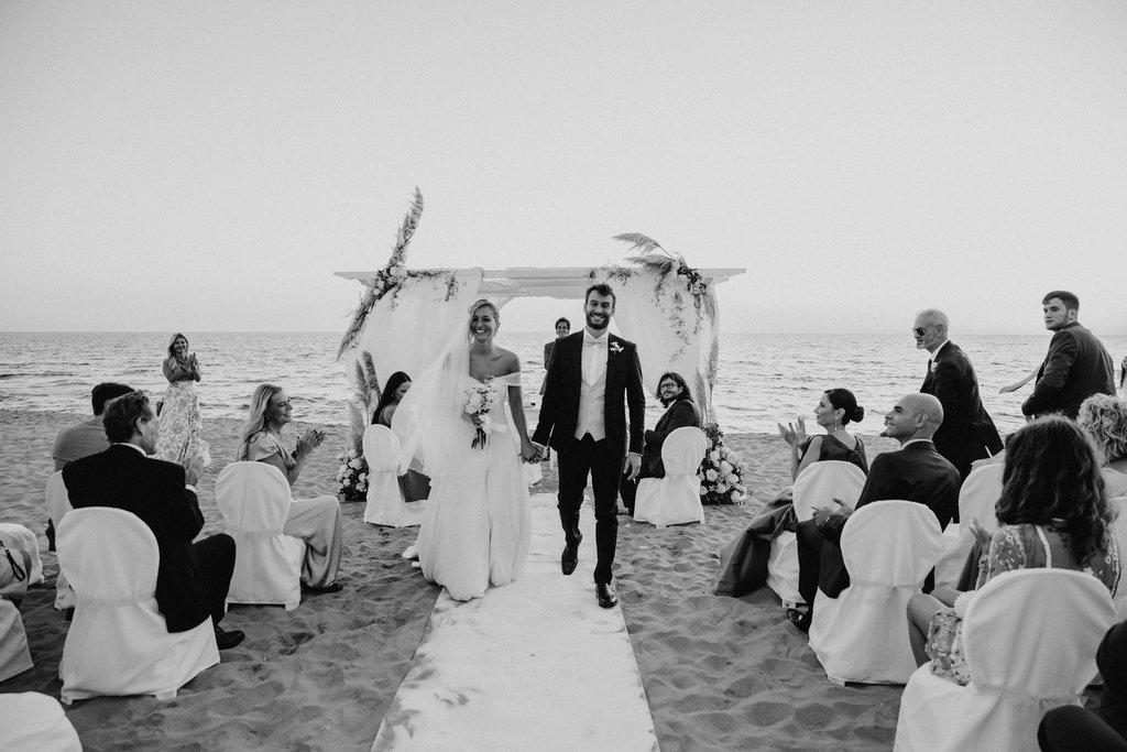 bride-groom-walking-down-the-aisle-civil-beach-wedding-