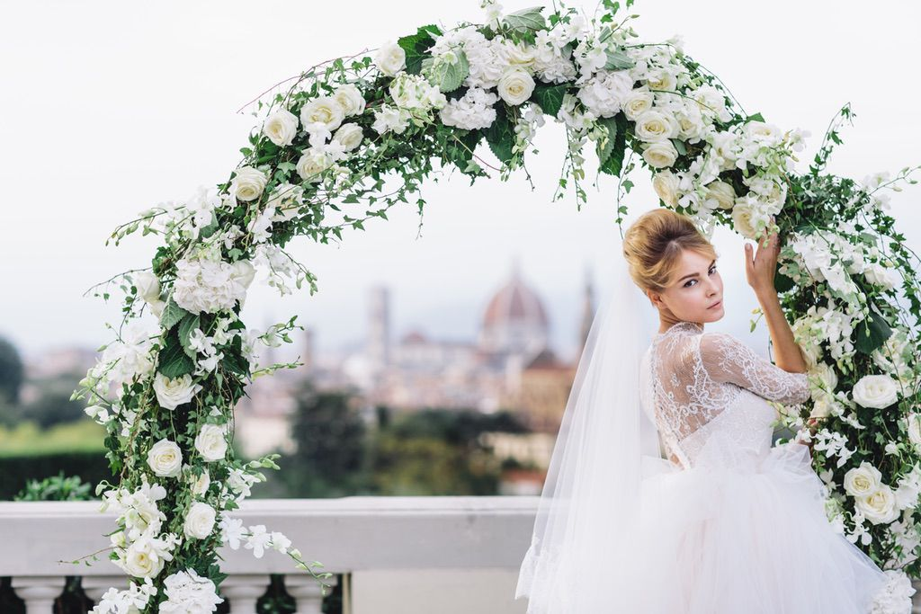 white and green flower's arch and bride real wedding in Italy