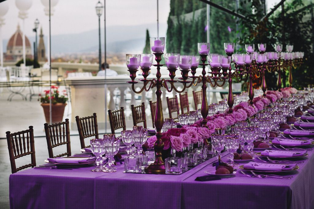 luxury pink wedding dinner table with candles and roses in the center of Firenze
