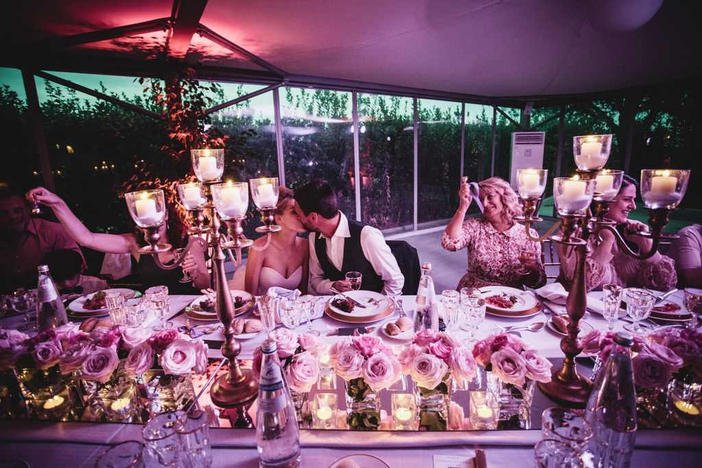bride and groom guests pink luxury wedding dinner table